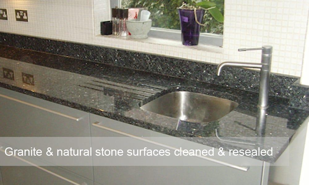 Polishing granite work tops. Essex